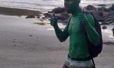 Homem foi pintado com tinta verde após fazer pichação (Foto: Reprodução/Facebook)