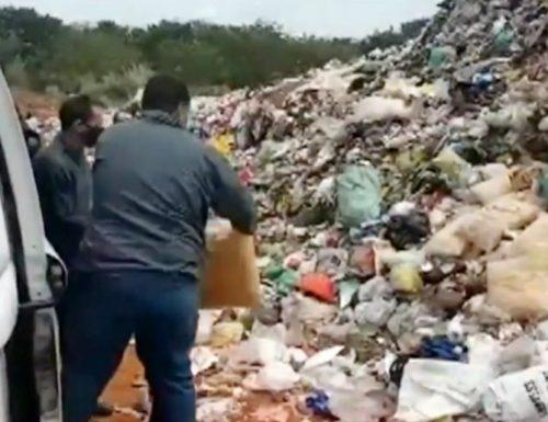 Servidores da prefeitura durante o descarte dos alimentos no aterro sanitário da cidade: polêmica (Foto: Reprodução/Arquivo pessoal)